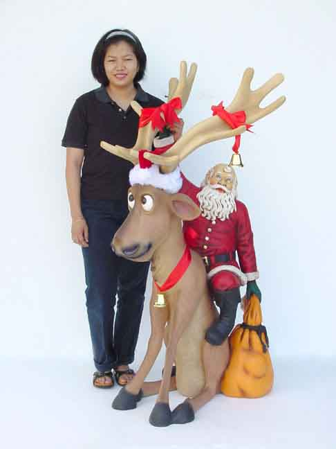 Funny Reindeer Sitting with Santa Claus