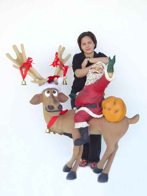 Funny Reindeer Standing with Santa Claus